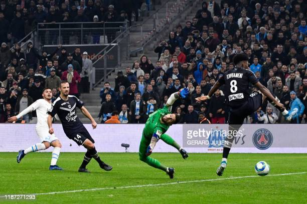 TOPSHOT Marseille's Serbian forward Nemanja Radonjic shoots and scores a goal past Bordeaux's French goalkeeper Benoit Costil during the French L1...