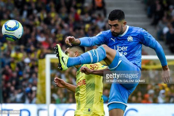 Marseille's Spanish defender Alvaro Gonzales jumps to control the ball during the French L1 football match between FC Nantes and Olympique de...
