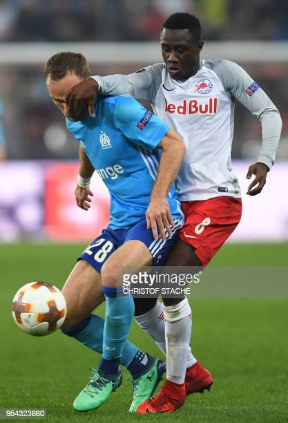 Marseille's striker Valere Germain and Salzburg's Malian midfielder Diadie Samassekou vie for the ball during the UEFA Europa League semifinal second...