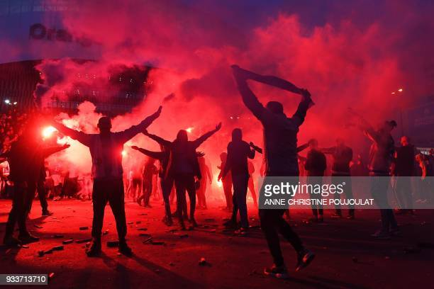 TOPSHOT Marseille's supporters burn flares on March 18 in front of the Velodrome Stadium in Marseille southeastern France before the French L1...