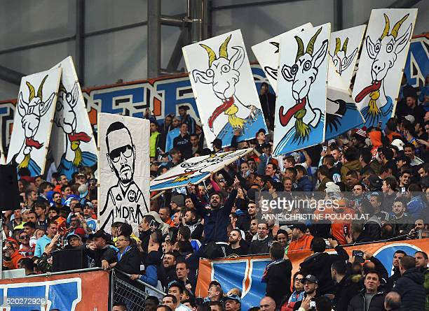 Marseille's supporters display placards showing goats and Bengous a YouTube commentator of the club during the French L1 football match Marseille vs...