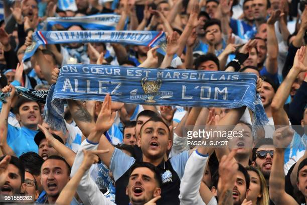 Marseille's supporters hold scarves prior to the UEFA Europa League firstleg semifinal football match between Olympique de Marseille and FC Salzburg...