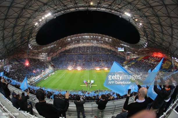 Marseille's supporters wave flags before the French L1 football match between Marseille and Paris SaintGermain on October 22 at the Velodrome Stadium...