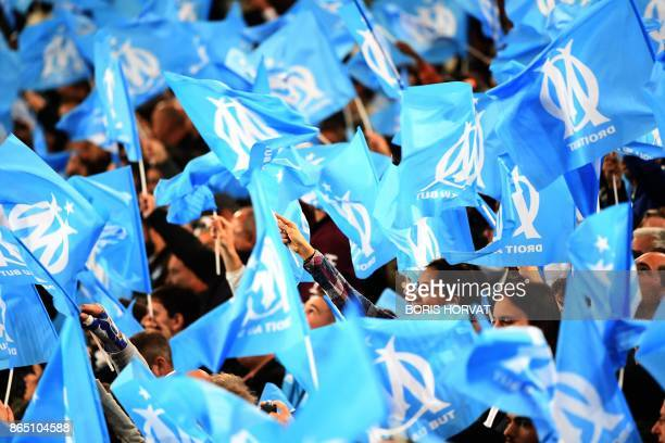 Marseille's supporters waves flags before the French L1 football match between Marseille and Paris SaintGermain on October 22 at the Velodrome...