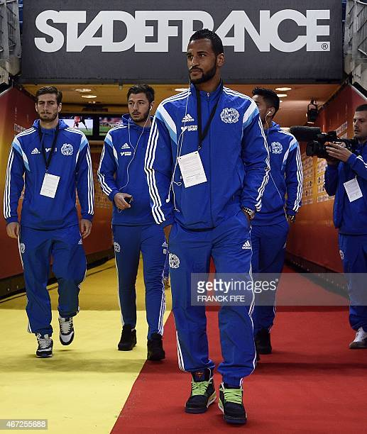 Marseille's Togolese midfielder JacquesAlaixys Romao arrives with teammates prior to the French L1 football match between Lens and Marseille on March...