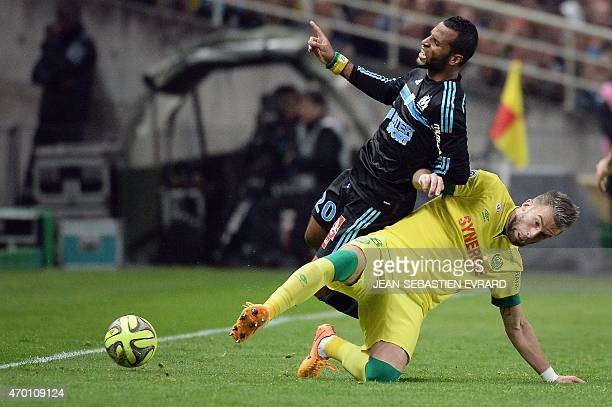 Marseille's Togolese midfielder JacquesAlaixys Romao is tackled by Nantes' French midfielder Lucas Deaux during the French L1 football match between...