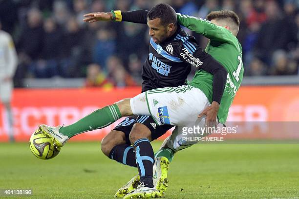 Marseille's Togolese midfielder JacquesAlaixys Romao vies with SaintEtienne's Dutch forward Ricky Van Wolfswinkel during the French L1 football match...