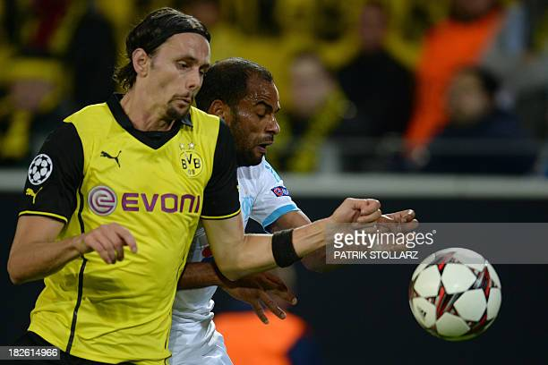 Marseille's Tunisian forward Saber Khalifa and Dortmund's Serbian defender Neven Subotic vie for the ball during the UEFA Champions League Group F...