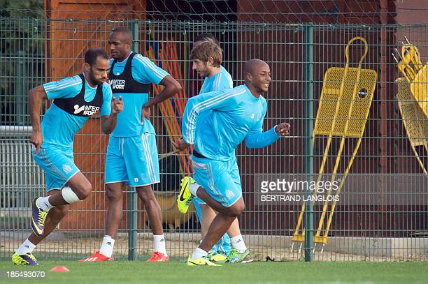 Marseille's Tunisian forward Saber Khalifa and Ghanaian forward Andre Ayew take part in a training session on the eve of the UEFA Champions League...
