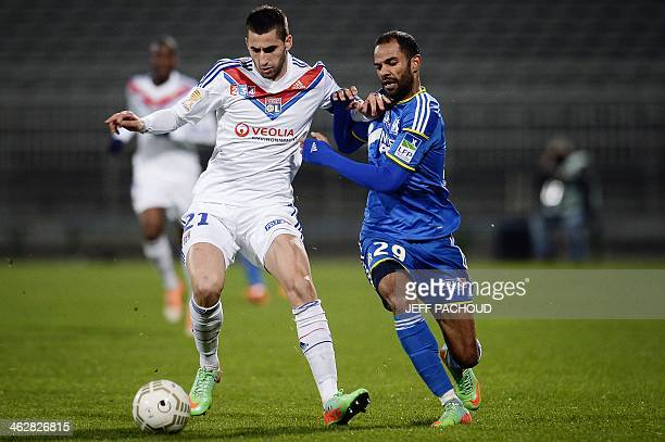 Marseille's Tunisian forward Saber Khalifa vies with Lyon's French midfielder Maxime Gonalons during the French League Cup quarter final football...