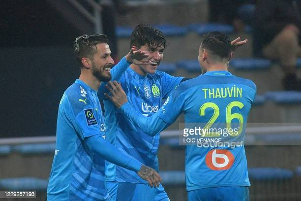Marseille's Uruguayan defender Leonardo Balerdi celebrates after scoring a goal during the French L1 football match between Lorient and Marseille at...