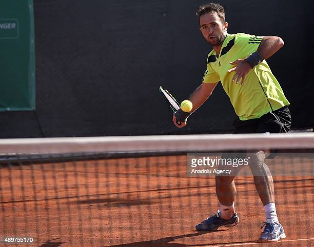 Marsel Ilhan of Turkey returns the ball to Maxime Hamou of France during their men's singles tennis match at 4th Mersincup ATP Challenger tennis...