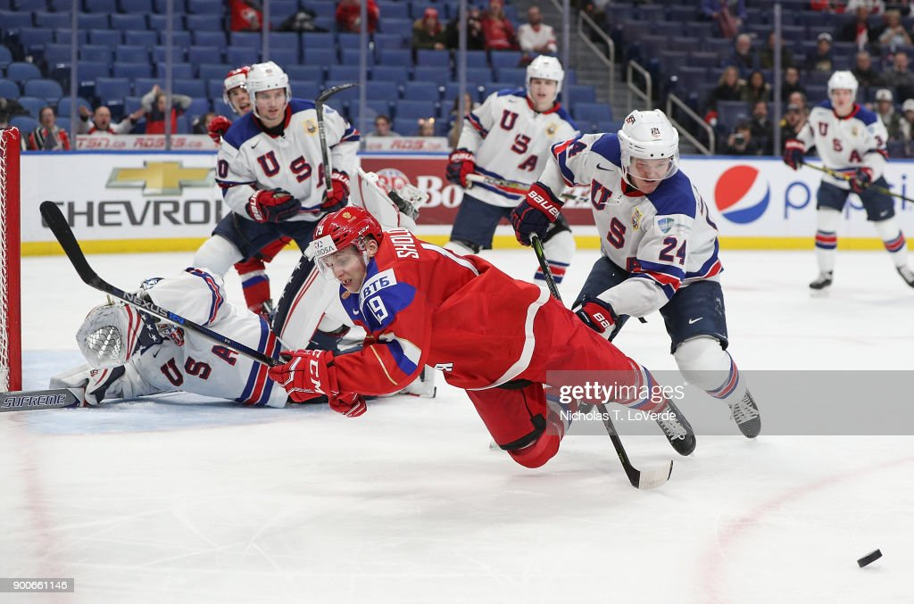Marsel Sholokhov #19 of Russia gets tripped up by Mikey Anderson #24 of United States during the third period of play in the Quarterfinal IIHF World Junior Championship game at the KeyBank Center on January 2, 2018 in Buffalo, New York.