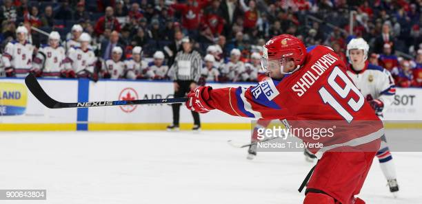 Marsel Sholokhov of Russia shoots the puck against the United States during the first period of play in the Quarterfinal IIHF World Junior...