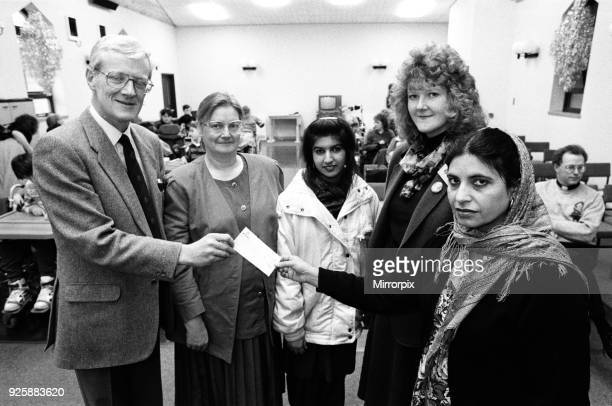 Marsh Adult Education Centre and Training for life Lockwood present a cheque for £250 to Holly Bank school Mirfield 13th December 1991