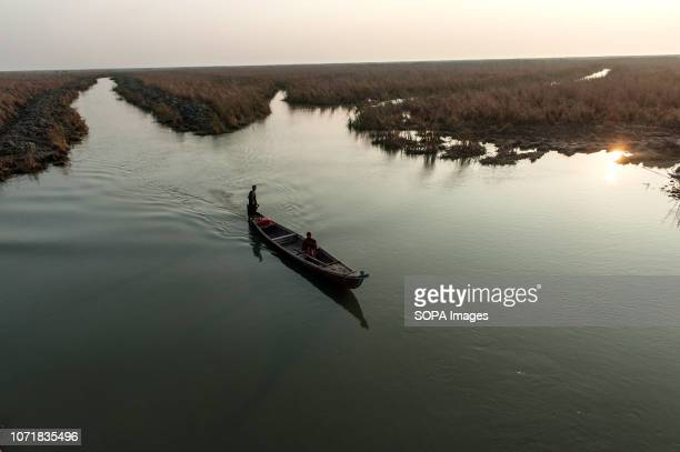 Marsh Arab boatmen seen in the Hamar Marsh of the Southern wetlands of Iraq. Climate change, dam building in Turkey and internal water mismanagement...