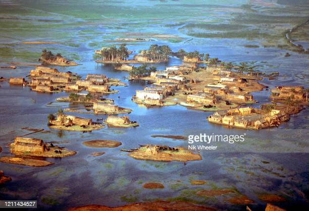 Marsh Arab villages of woven reed houses on small islands dot the landscape where the Tigris and Euphrates Rivers meet at the legendary site of the...