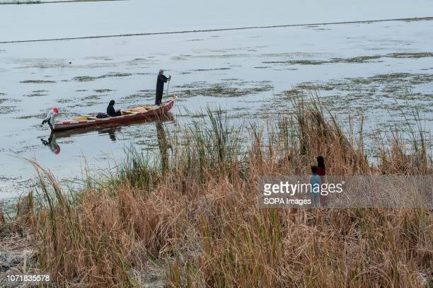 Marsh Arabs seen on the river Euphrates at Al-Chibayish in the Southern wetlands of Iraq. Climate change, dam building in Turkey and internal water...
