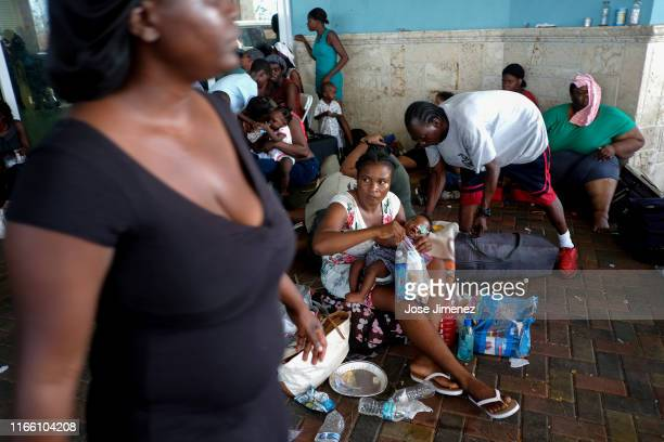 Marsh Harbor residents wait at Leonard M Thompson International Airport while trying to evacuate the island on September 5 2019 in Great Abaco Island...