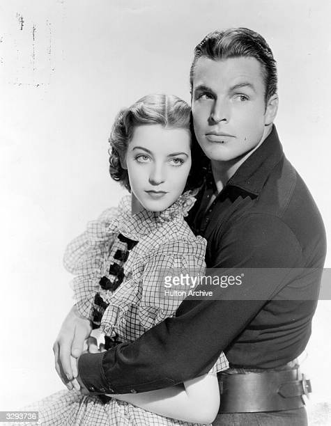 Marsha Hunt and Buster Crabbe star in 'Arizona Raiders' directed by William Witney for Columbia