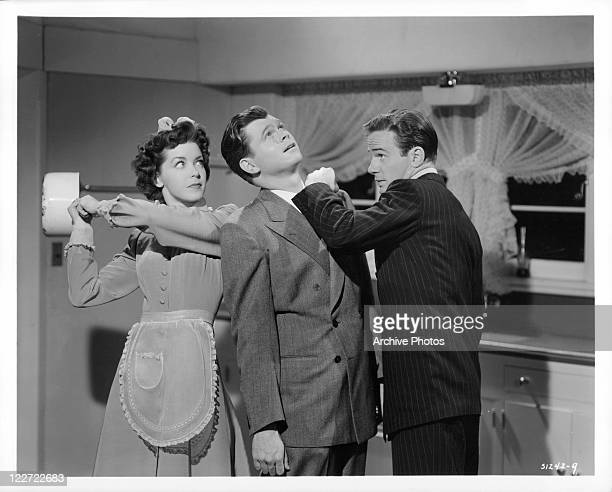Marsha Hunt is about to hit Barry Nelson on the head with a pot in a scene from the film 'The Affairs Of Martha', 1942.