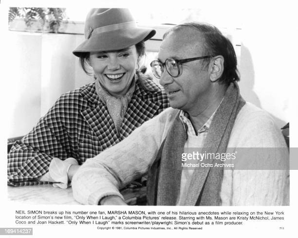 Marsha Mason laughs with Neil Simon in between takes from the film 'Only When I Laugh' 1981
