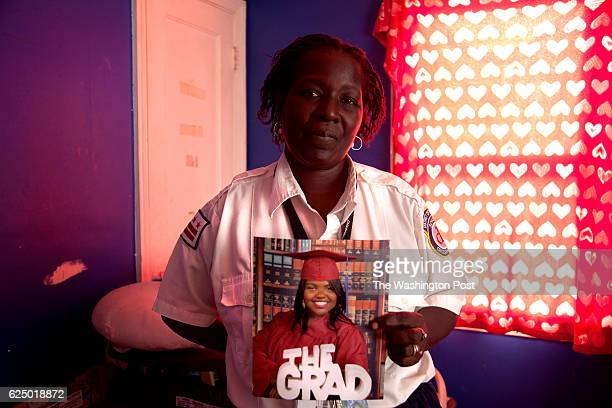 Marsha Mayo holds a photograph of her daughter Elsie in her home in Washington DC on December 4 2012 Elsie underwent expulsion proceedings at...