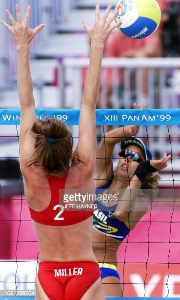 Marsha Miller of the US tries to block the shot of Adriana Behar of Brazil in their Beach Volleyball gold medal match at the XIII Pan Am Games 04...