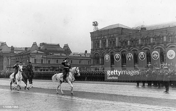 Marshal georgy zhukov accompanied by commander of the parade, marshal of the soviet union, k, rokossovsky riding across red square prior to the...