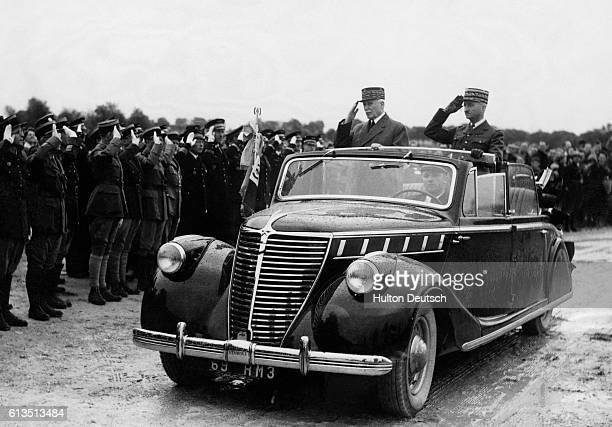 Marshal Henri Philippe Petain Premier of the Vichy government and General Bridoux the Secretary for War salute the French Army of Armistice during an...