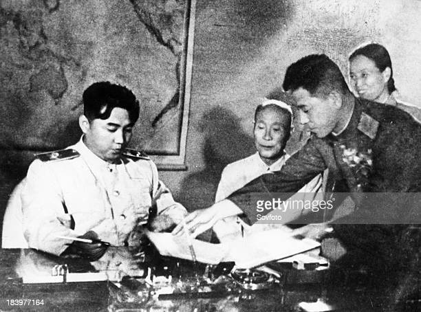 Marshal Kim Il Sung signing the Korean Armistice Agreement and the Temporary Agreement Supplementary to the Armistice Agreement at 10pm on July 27,...
