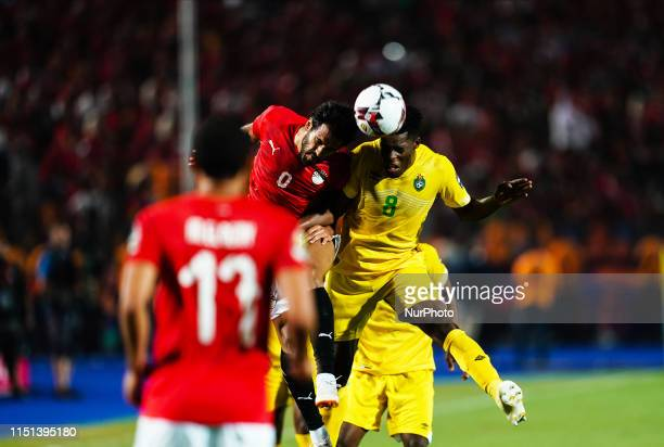 Marshal Nyasha Munetsi of Zimbabwe and Tarek Hamed of Egypt challenging for the ball during the African Cup of Nations match between Egypt and...