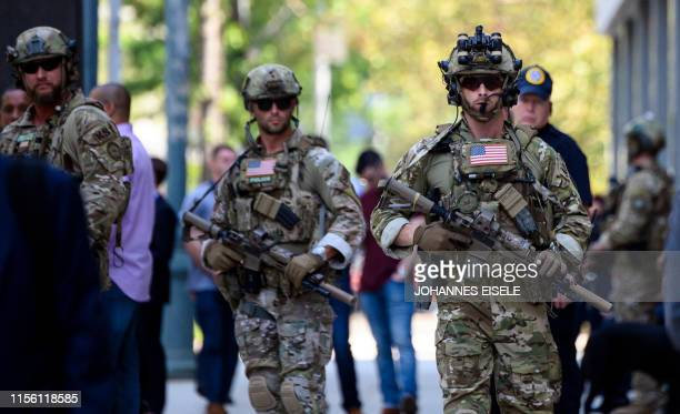 US Marshal security police stand out at the Brooklyn Federal Court on July 17 after Mexican drug lord Joaquin El Chapo Guzman's sentencing in New...