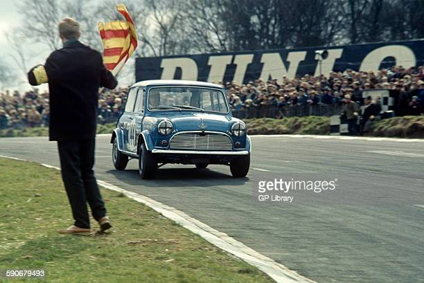Marshal waving an oil flag at Gordon Spice in an Austin Mini Cooper Race of Champions Trophy Guards Trophy 17 March 1968