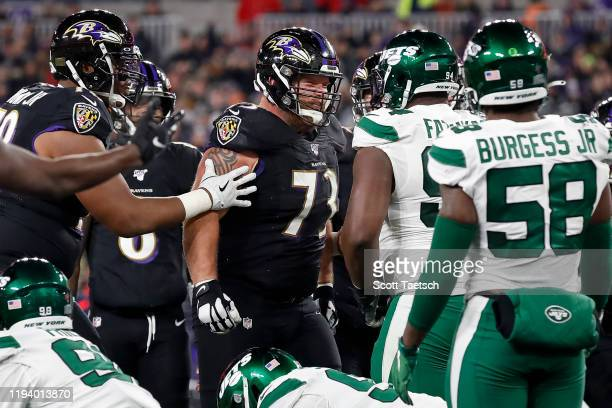 Marshal Yanda of the Baltimore Ravens has words with Foley Fatukasi of the New York Jets during the first half at M&T Bank Stadium on December 12,...