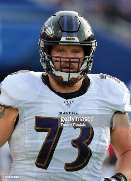 Marshal Yanda of the Baltimore Ravens runs onto the field before a game against the Buffalo Bills at New Era Field on December 8 2019 in Orchard Park...
