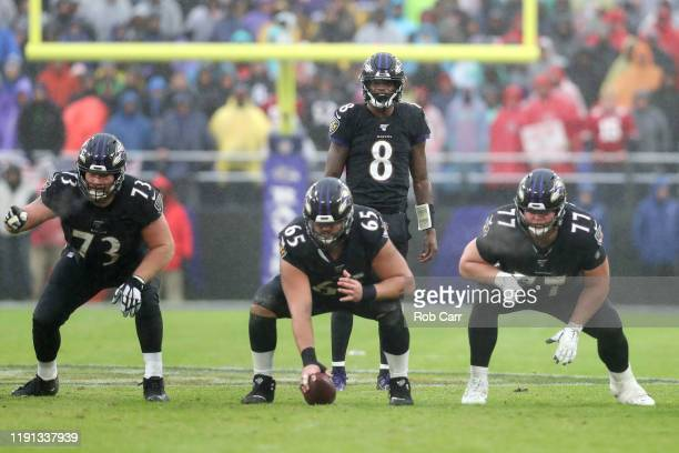 Marshal Yanda Patrick Mekari Bradley Bozeman and Lamar Jackson of the Baltimore Ravens line up against the San Francisco 49ers defense in the second...