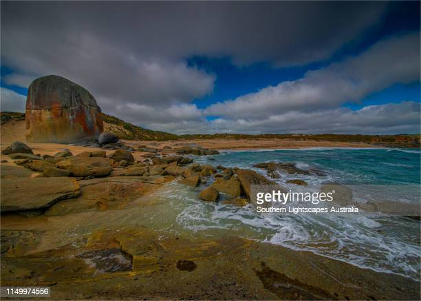 marshall bay and views of castle rock, western coastline of flinders island, bass strait, tasmania. - bass strait stock pictures, royalty-free photos & images