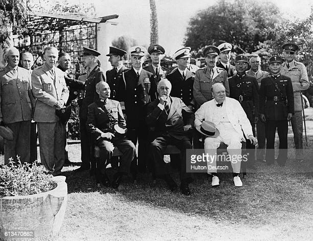 Marshall Chiang KaiShek with Franklin Roosevelt and Sir Winston Churchill at a wartime conference between international governmental and military...