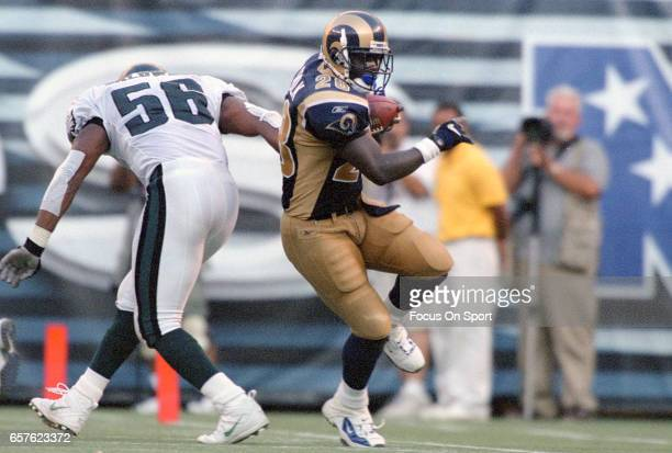 Marshall Faulk of the St Louis Rams carries the ball against the Philadelphia Eagles during an NFL football game September 9 2001 at Veterans Stadium...