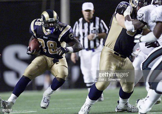 Marshall Faulk of the St Louis Rams charges down the field during the game against the Philadelphia Eagles at Veterans Stadium in Philadelphia...