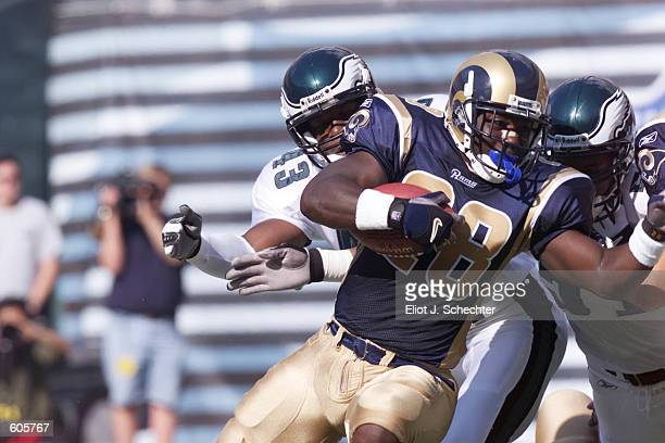 Marshall Faulk of the St Louis Rams gets down near the goal line to set up a touchdown in the first quarter against the Philadelphia Eagles at...