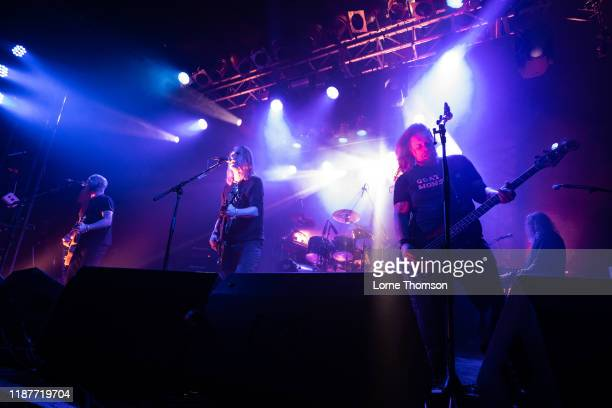 Marshall Gill, Justin Sullivan and Ceri Monger of New Model Army perform at Electric Ballroom on November 14, 2019 in London, England.