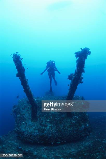 Marshall Islands, female diver exploring aircraft carrier