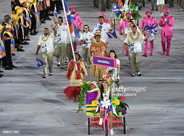 Marshall Islands' flagbearer Mathlynn Sasser leads her delegation during the opening ceremony of the Rio 2016 Olympic Games at the Maracana stadium...