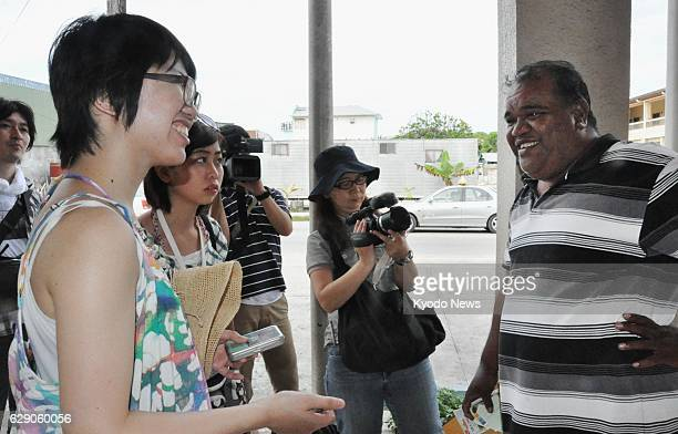 MAJURO Marshall Islands Keiko Takahashi a law student at Fukushima University talks to Dean Langinbelik a local assemblyman in the Marshall Islands...