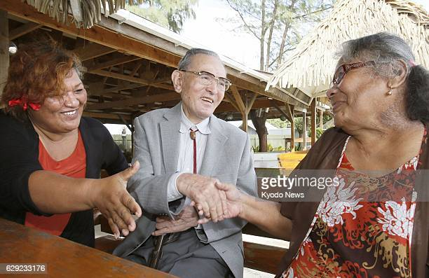 MAJURO Marshall Islands Nerje Joseph a Marshallese survivor of the 1954 powerful nuclear test by the United States at Bikini Atoll shakes hands with...