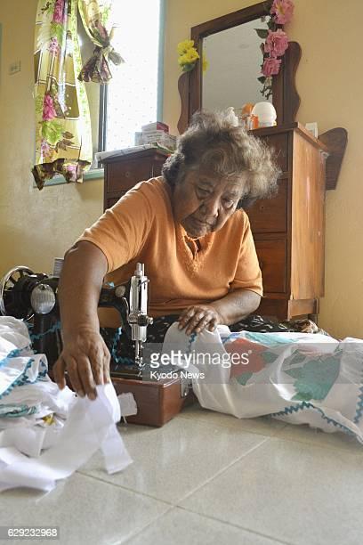 Marshall Islands - Photo taken Jan. 21, 2014 shows Lemeyo Abon, survivor of radioactive fallout from a 1954 U.S. Hydrogen bomb test on the Bikini...