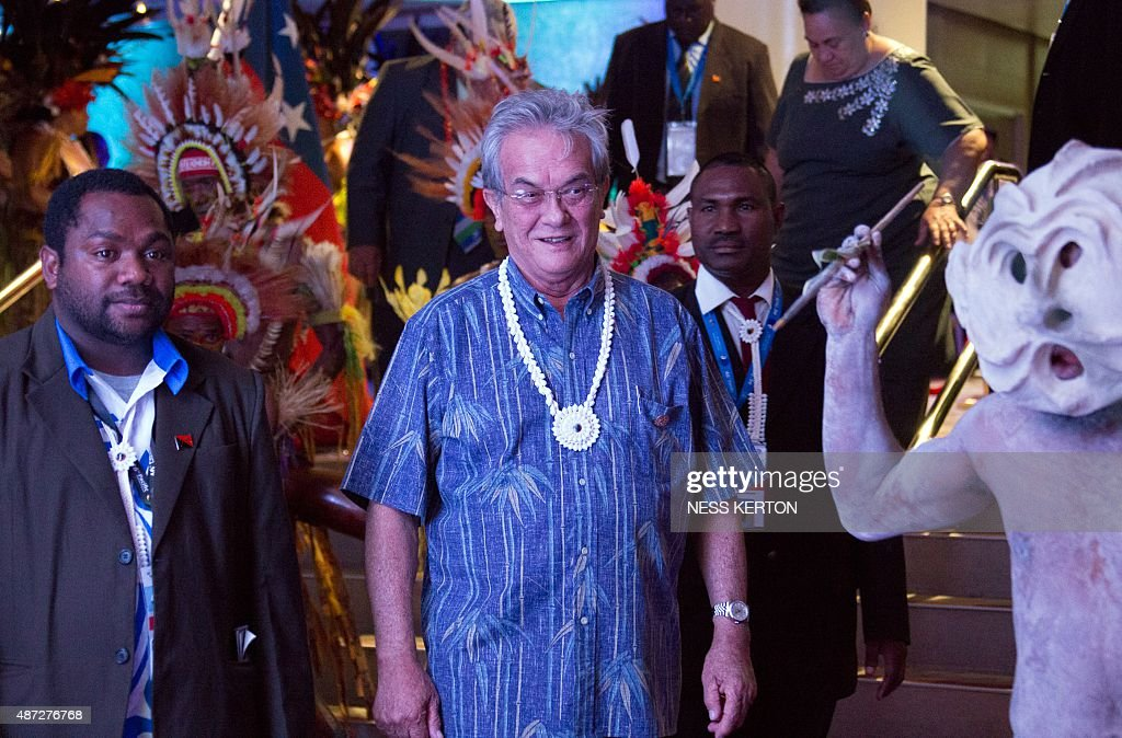 Marshall Islands President Christopher Loeak (C) arrives for the official opening of the 46th Pacific Islands Forum (PIF) in Port Moresby on September 8, 2015. The 16-nation grouping consists mainly of small island nations, together with Australia and New Zealand, with the two developed nations being accused of dragging their feet on climate change. AFP PHOTO/Ness KERTON