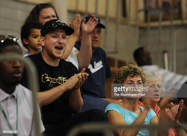 KC Marshall left in black cheers with his mom Shari Krantz center and grandmother Cheryl McCullen right for his sister Amy Marshall during the...